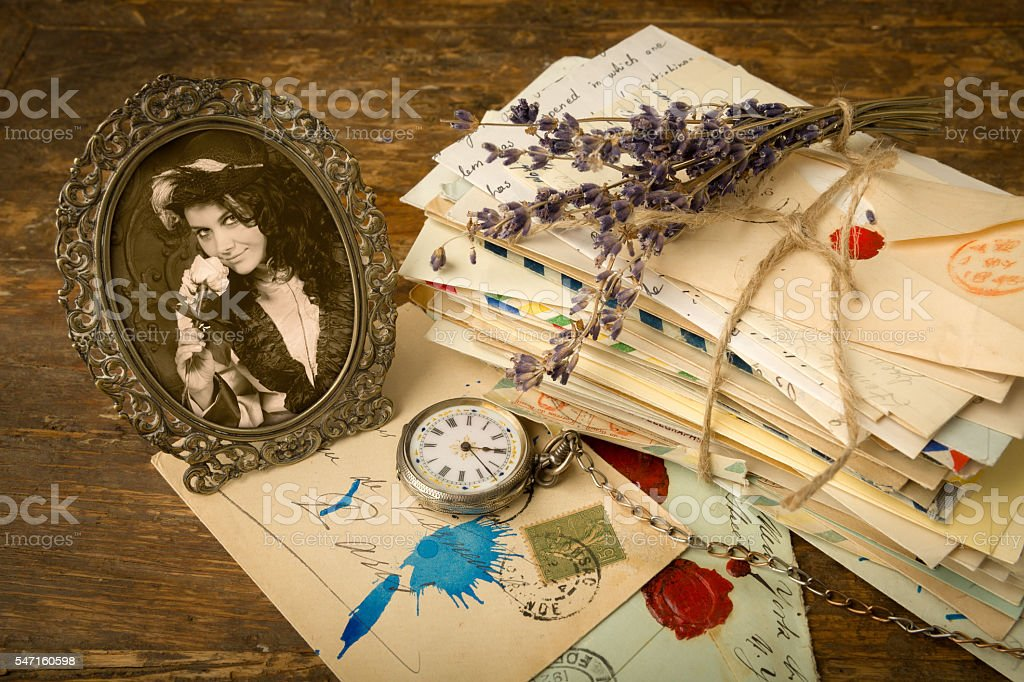 Antique portrait and old letters stock photo