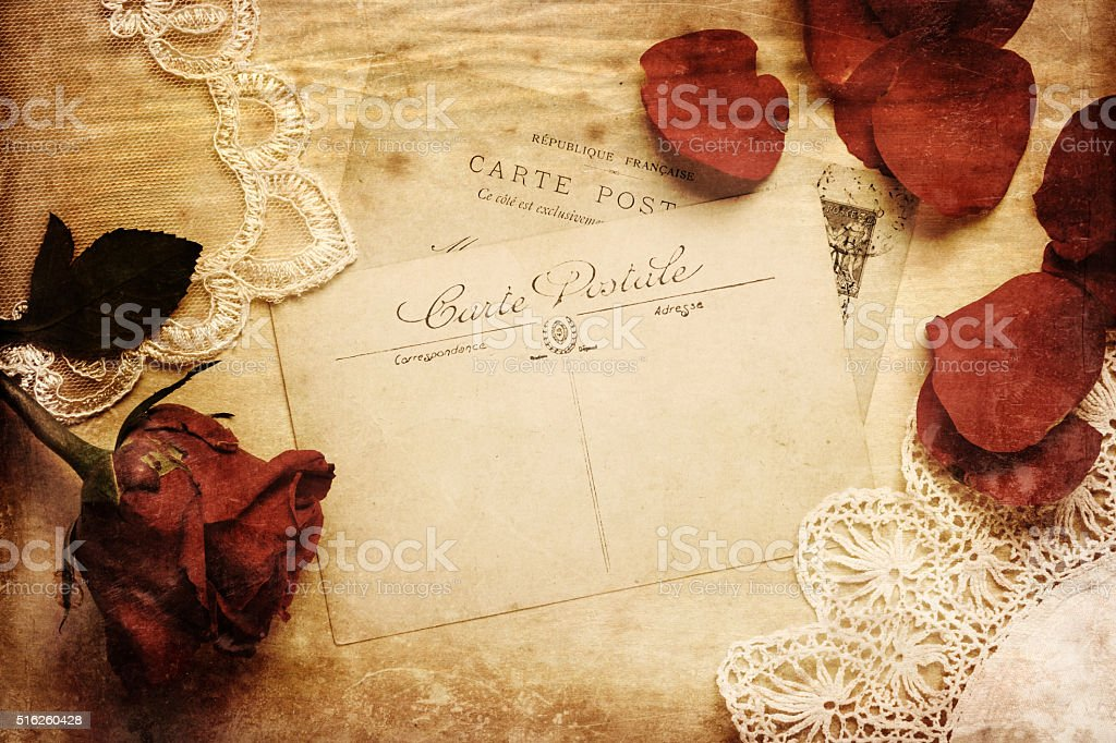 antique postcard with rose and embroidery stock photo