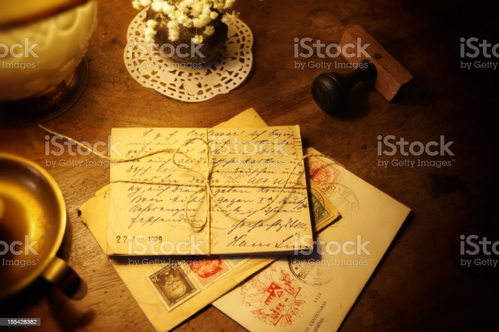 Antique postcards and letters on a wooden desk stock photo