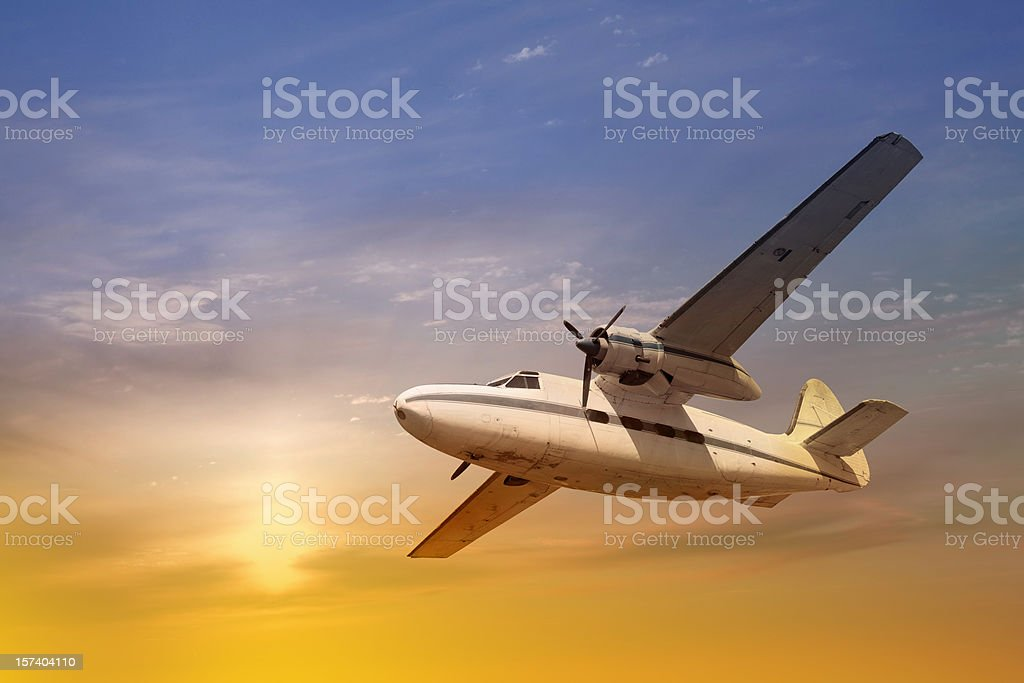 Antique propeller airplane at sunset stock photo
