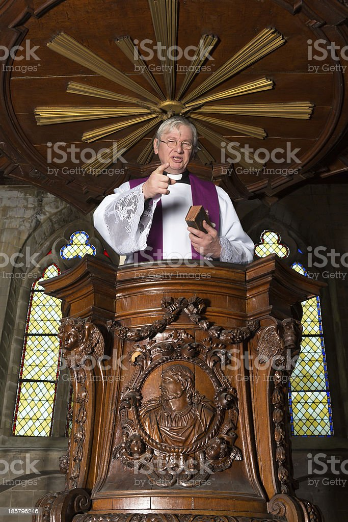 Antique pulpit and priest stock photo