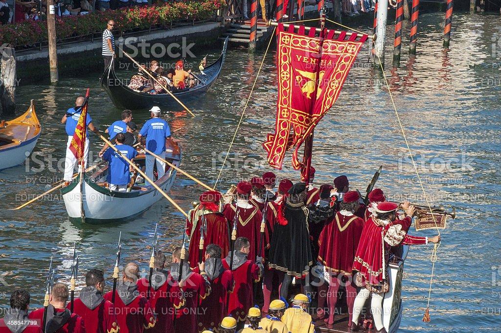 Antique Racing Gondolas Give Way to Historic Royal Warship royalty-free stock photo
