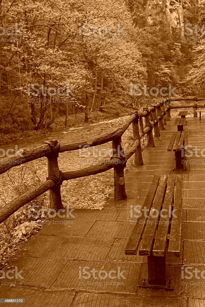 antique railings by a stream in Zhangjiajie National Geological stock photo