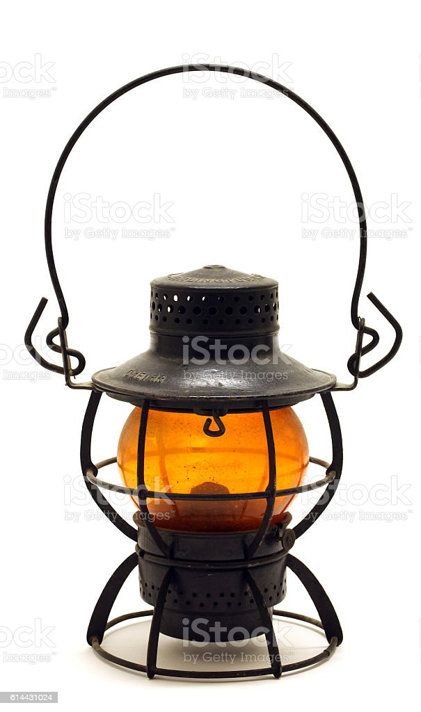 Antique Railroad Lantern isolated on white.  Copy space.  Vertical. stock photo