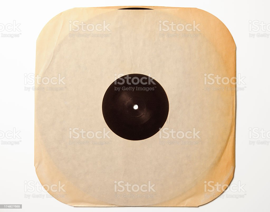 Antique Record's paper case with black LP on white background royalty-free stock photo