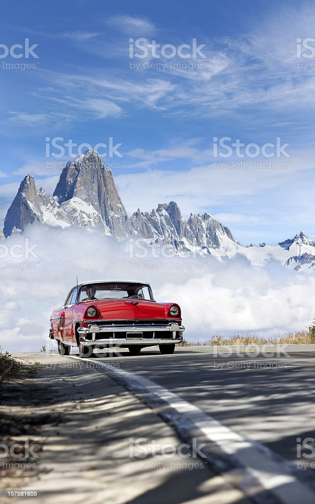 Antique red car driving in Argentina, Patagonia stock photo
