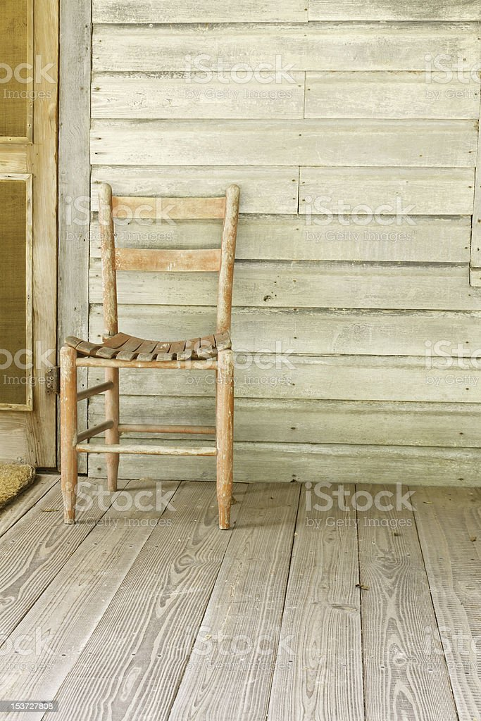 Antique Red Chair On Wood Farmhouse Porch royalty-free stock photo