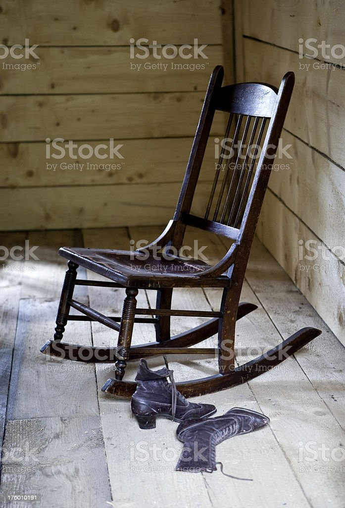 Antique Rocking Chair and Boots with Window Light stock photo
