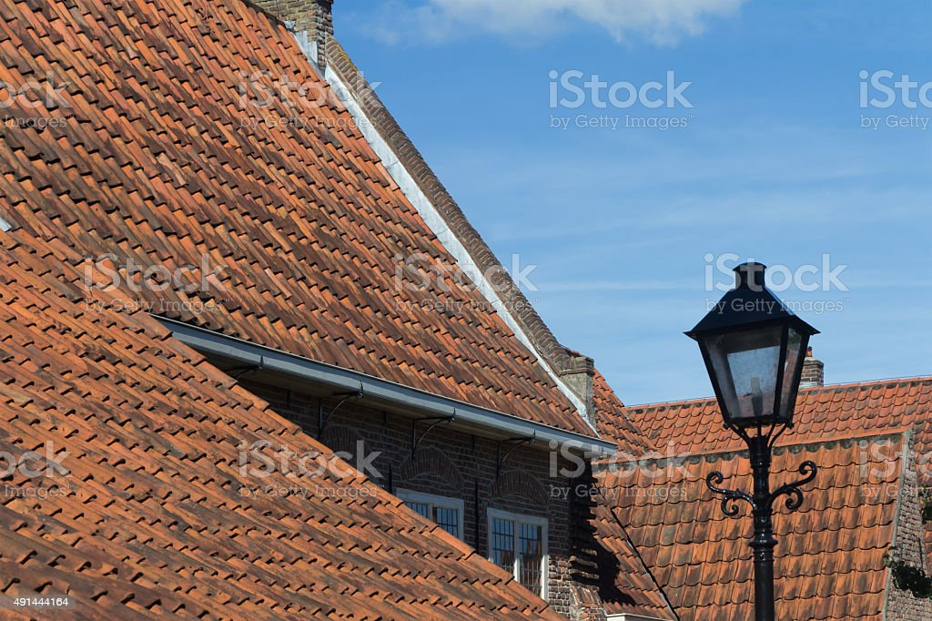 Antique roof tiles and lantern stock photo