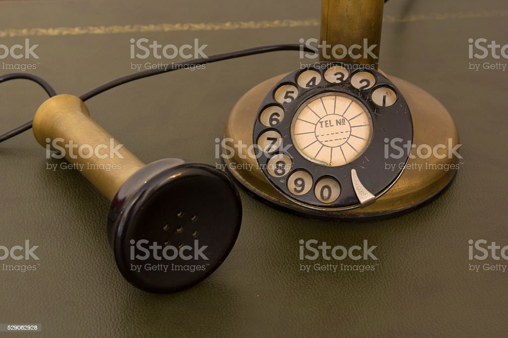 Antique rotary phone stock photo