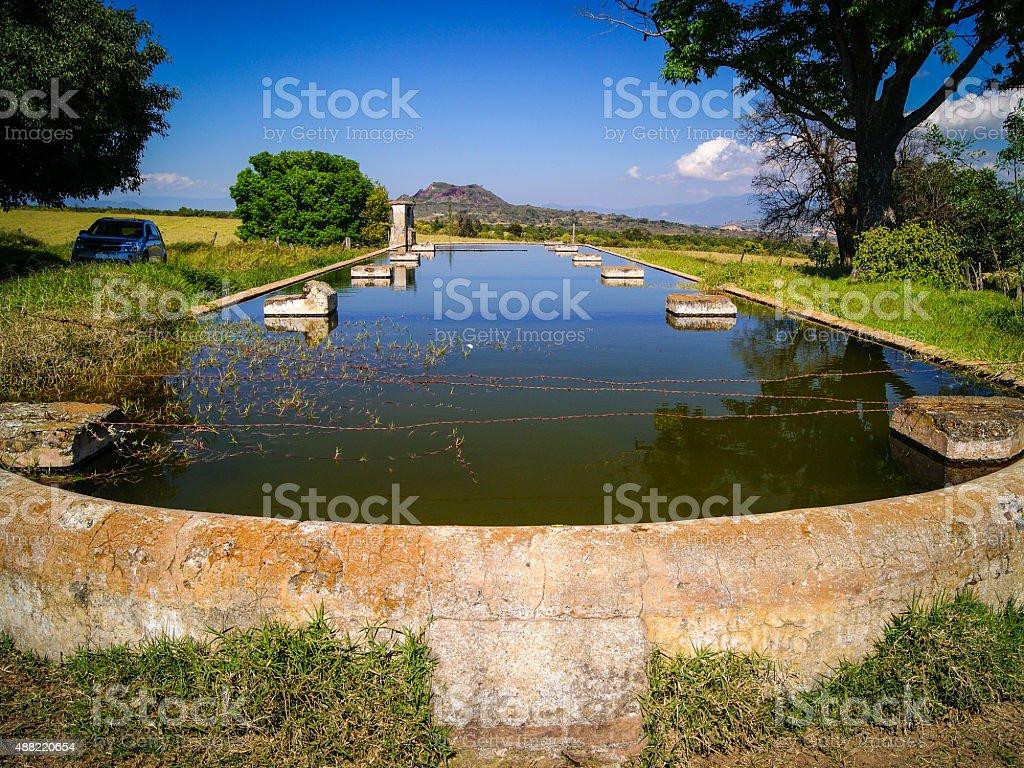 Antique rural fountain stock photo