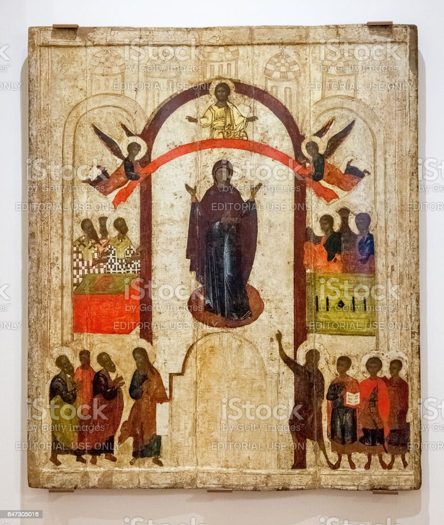 Antique Russian orthodox icon. The Protection of the Virgin painted on wooden board stock photo
