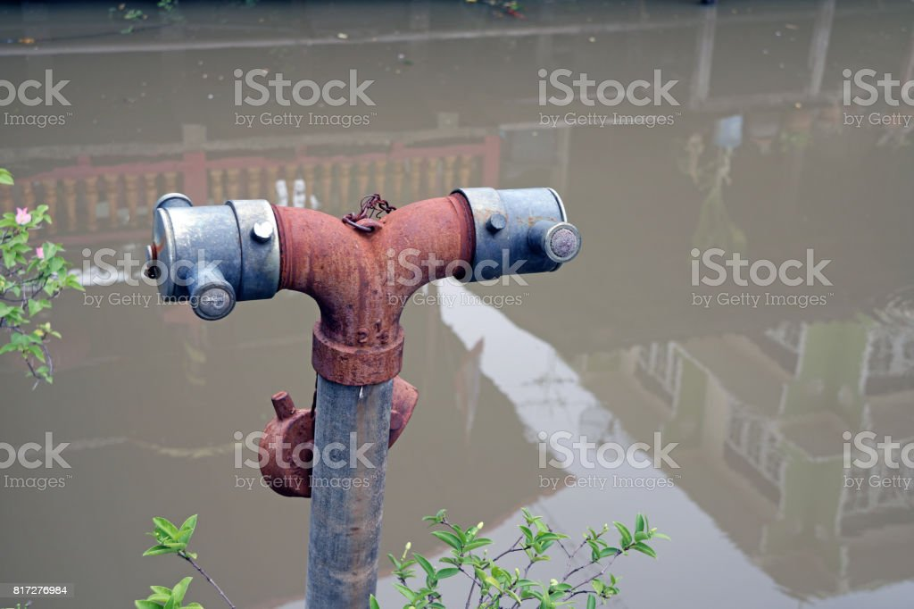 Antique rust Fire hydrant for village and canal background. stock photo