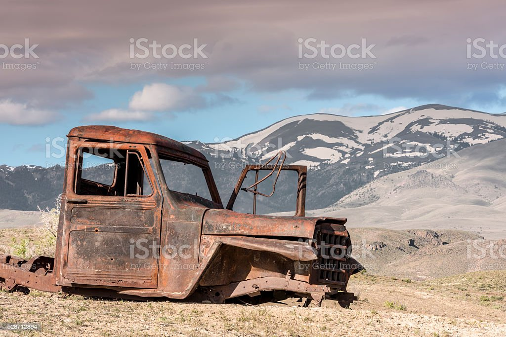 Antique rusted puckup truck and Idaho mountains stock photo