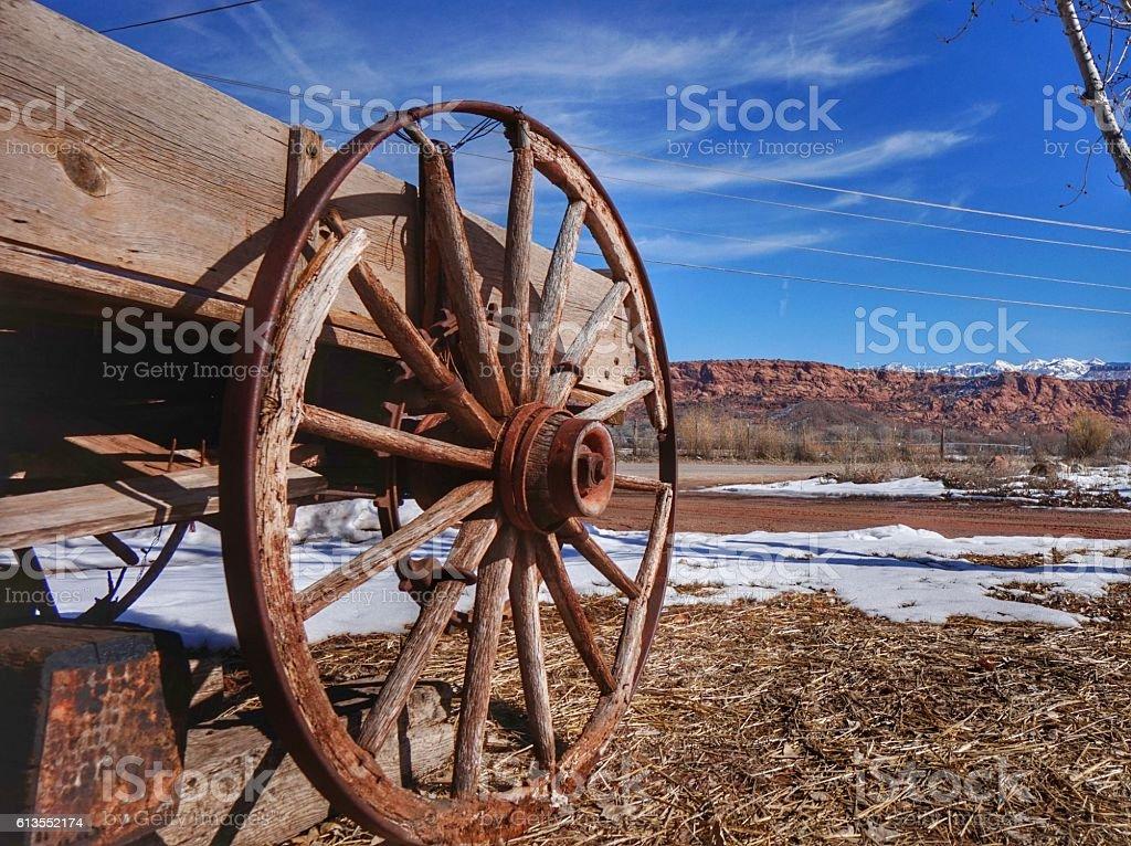 Antique Rusted Western Wagon Wheel, Snowy Moab Utah Landscape stock photo