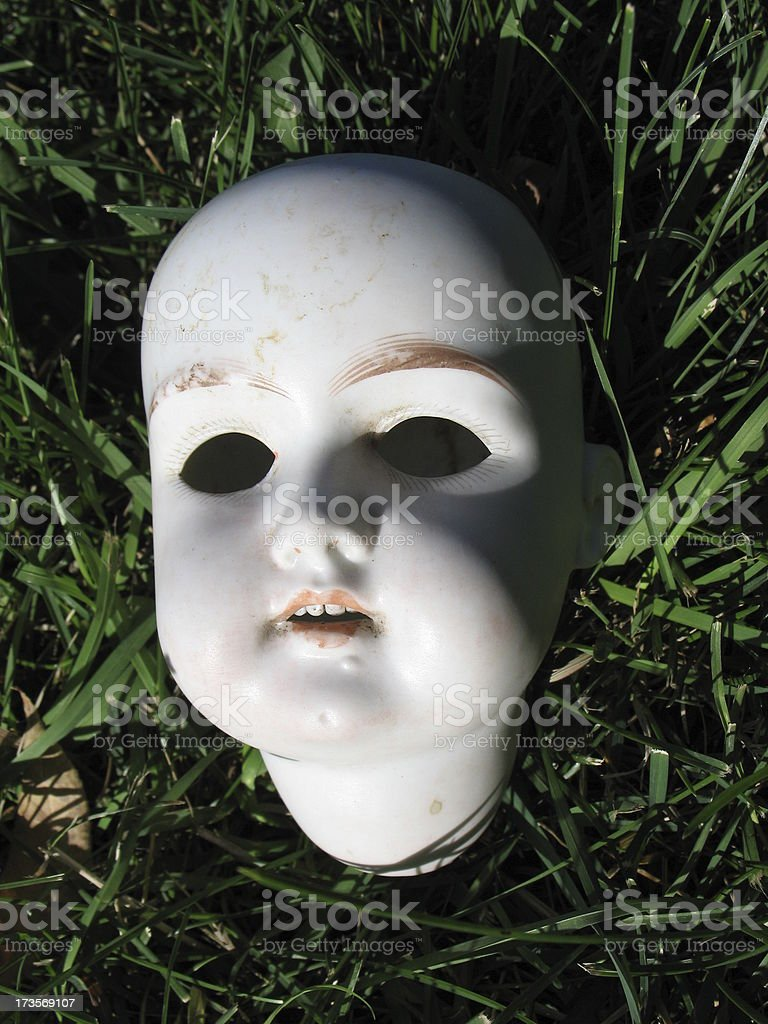 Antique Scary Doll Head stock photo