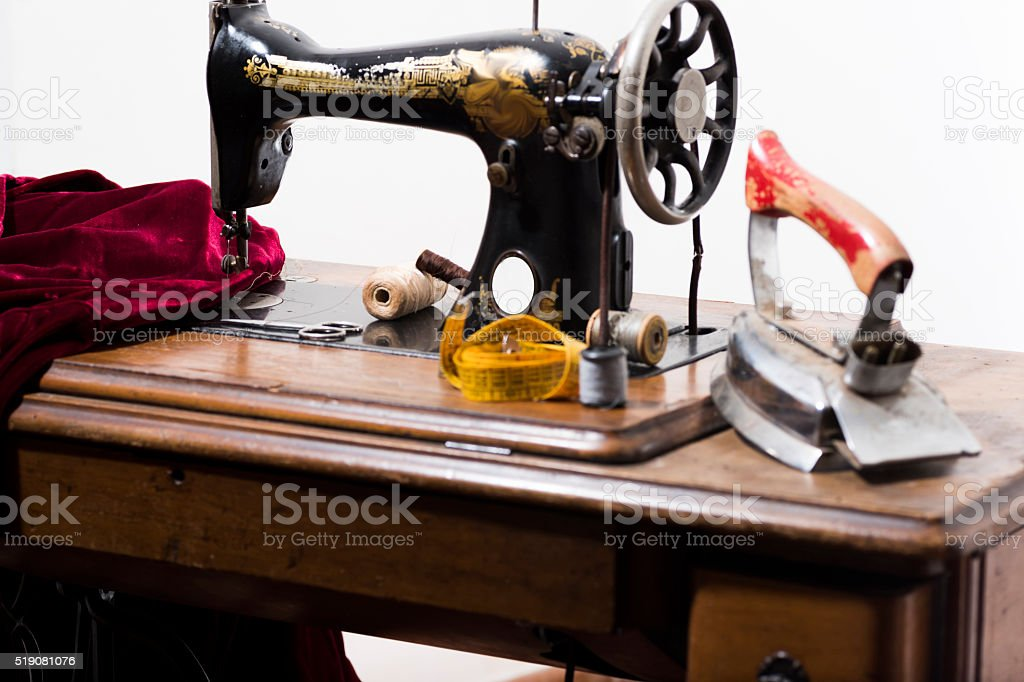 antique sewing machine in a study tailoring. stock photo