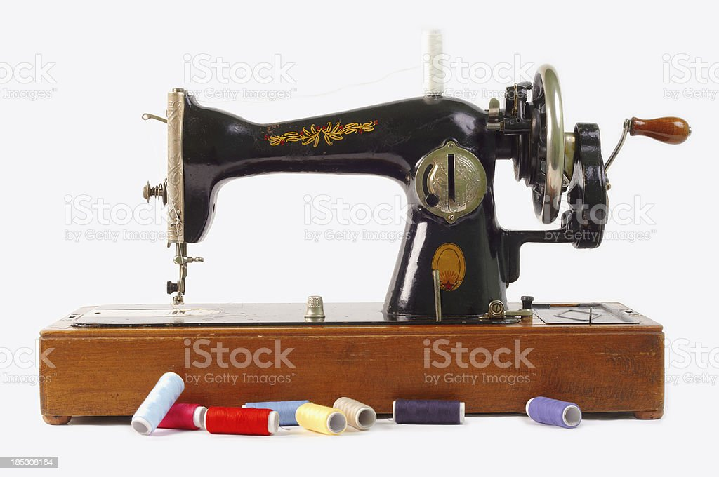 Antique Sewing Machine Isolated on White royalty-free stock photo