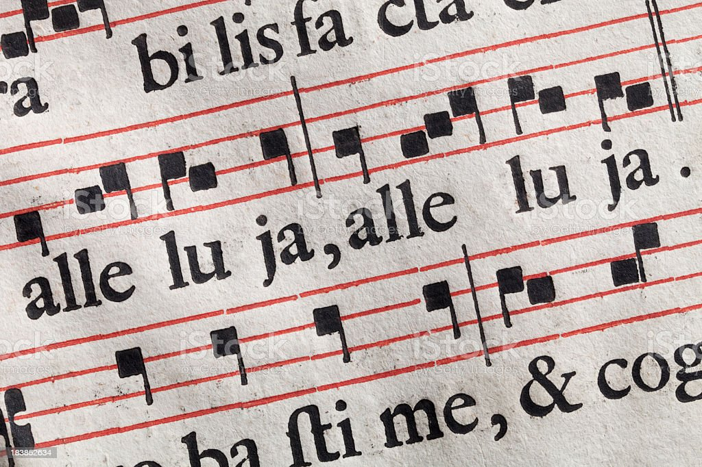 Antique sheet music. Latin hymnal parchment. stock photo