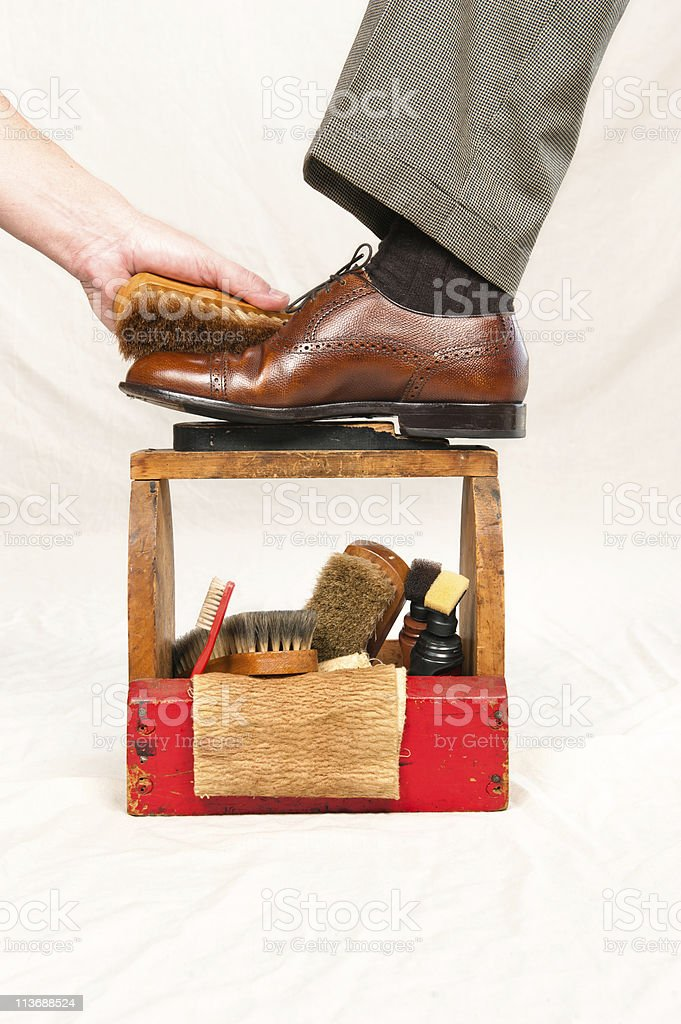 Antique shoe shine box and worker stock photo