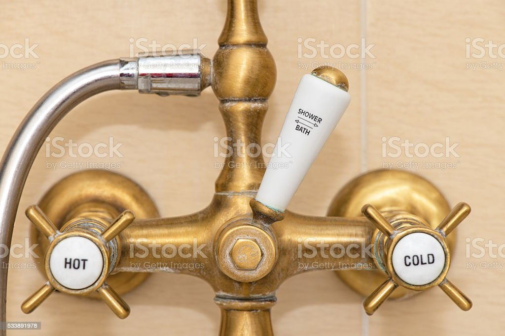 Antique shower and bath faucets stock photo