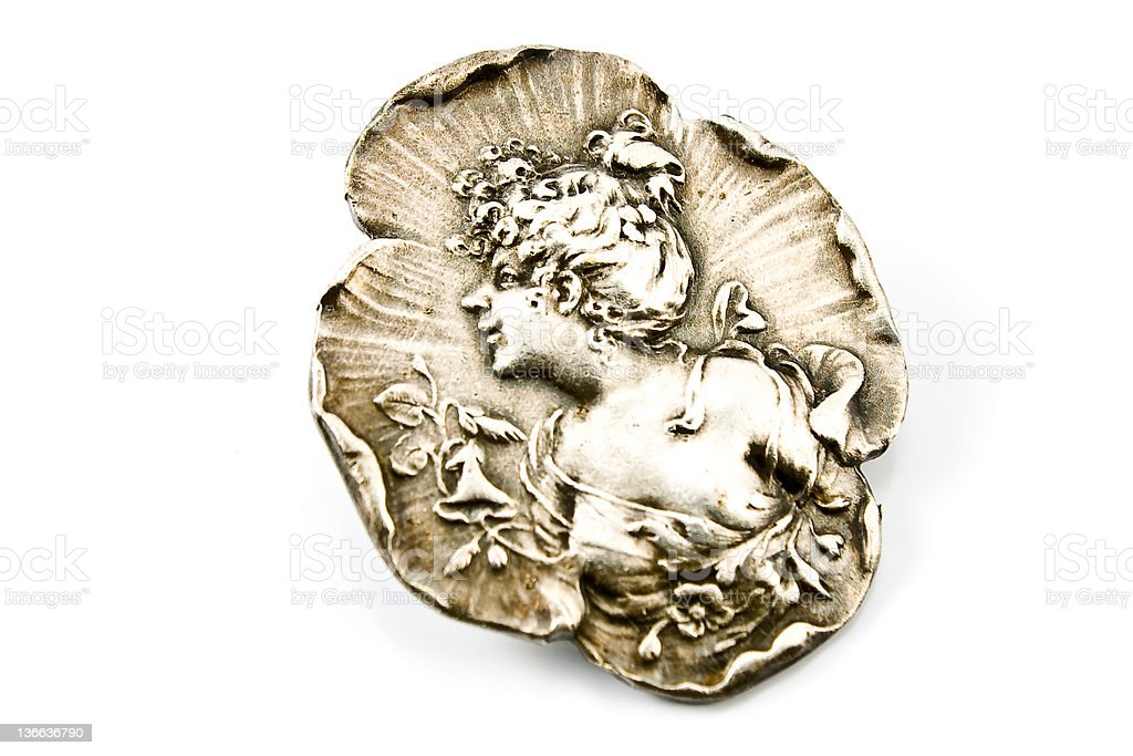 Antique silver brooch with woman's profile royalty-free stock photo