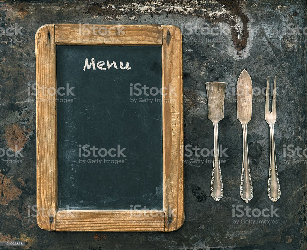 Antique silver cutlery and blackboard. Vintage style. Food concept stock photo