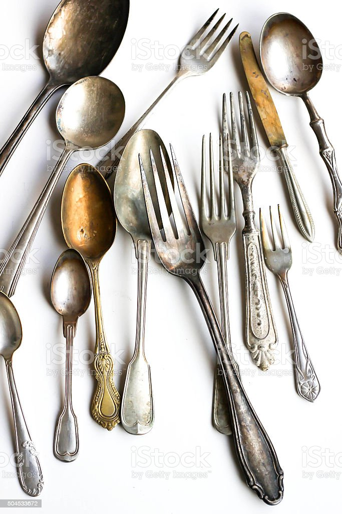 Antique Silver Cutlery on White Background stock photo