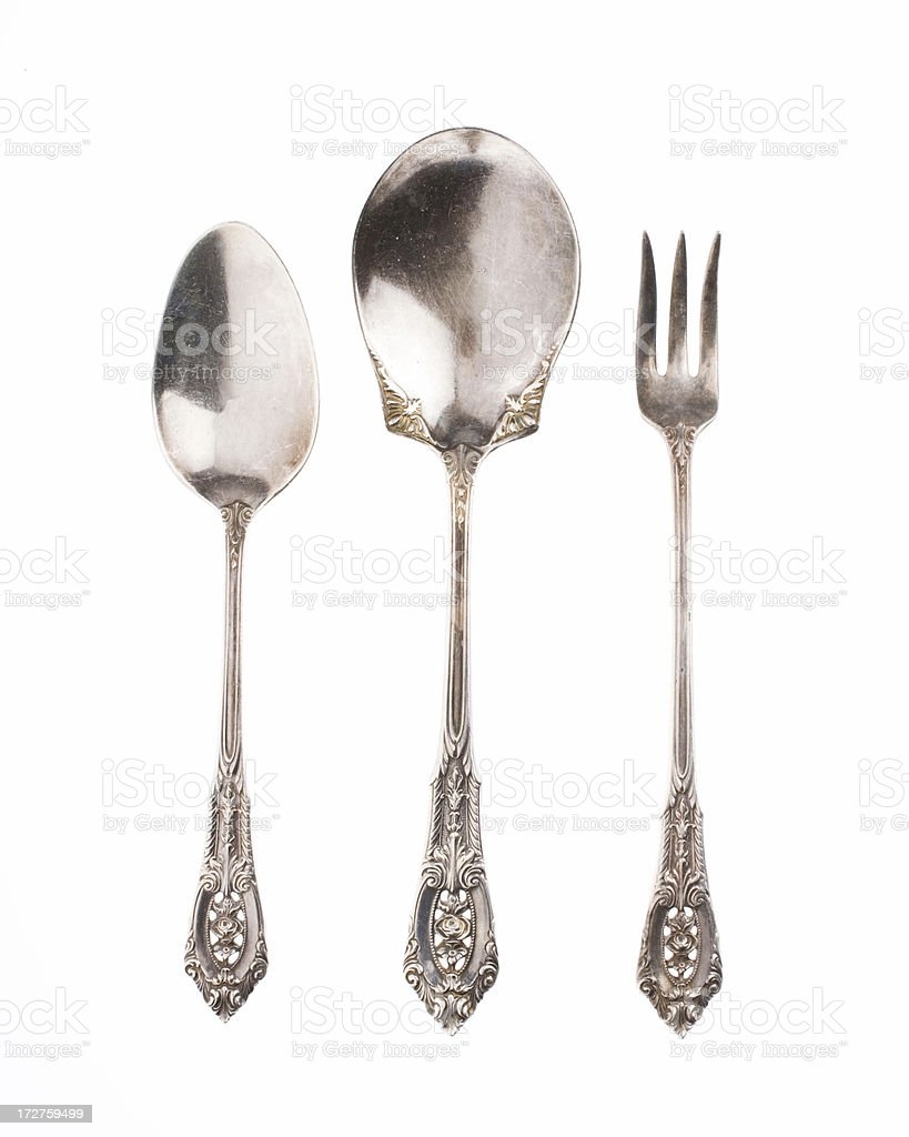Antique silver spoons and fork on white background stock photo