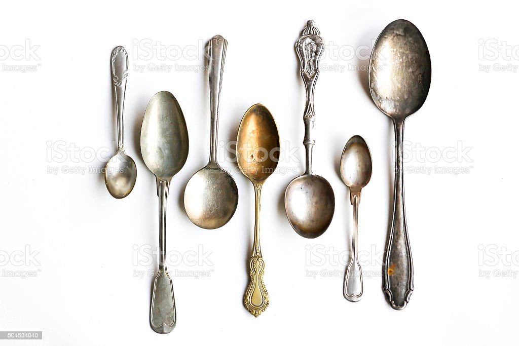 Antique Silver Spoons on White Background stock photo