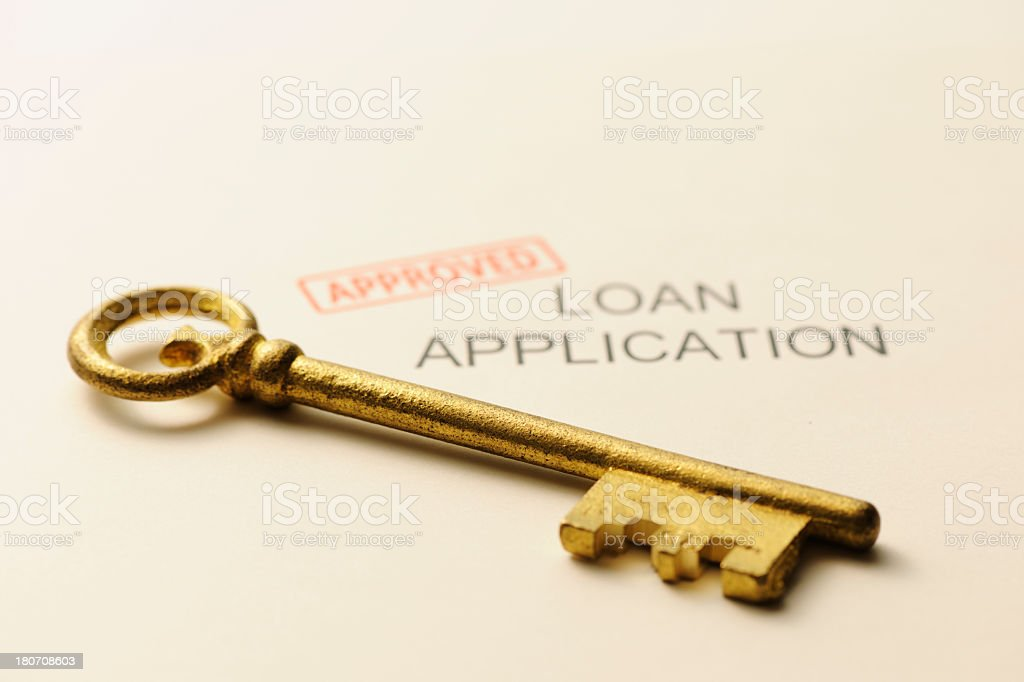 Antique skeleton key on approved application form royalty-free stock photo