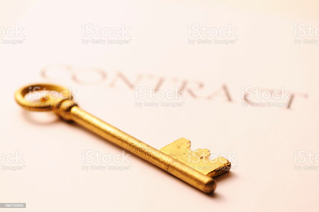 Antique skeleton key on contract with shallow depth of field royalty-free stock photo