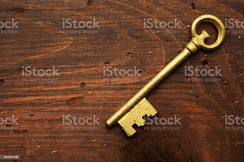 Antique skeleton key on the weathered table stock photo