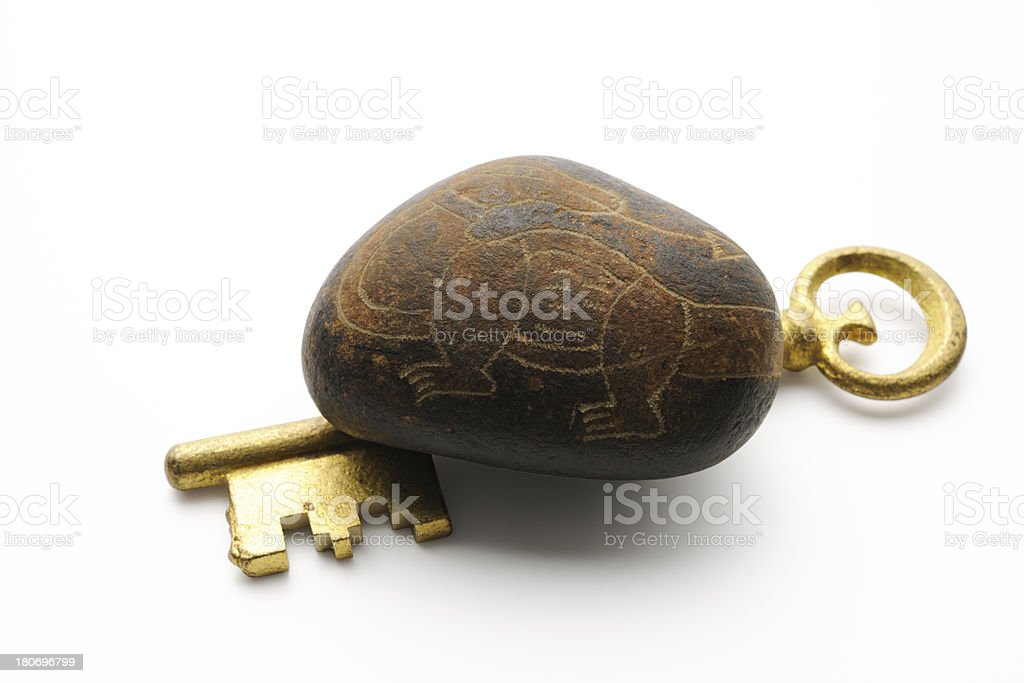 Antique skeleton key under ancient picture stone on white background royalty-free stock photo