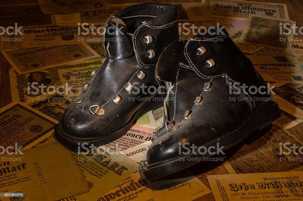Antique ski boots stock photo