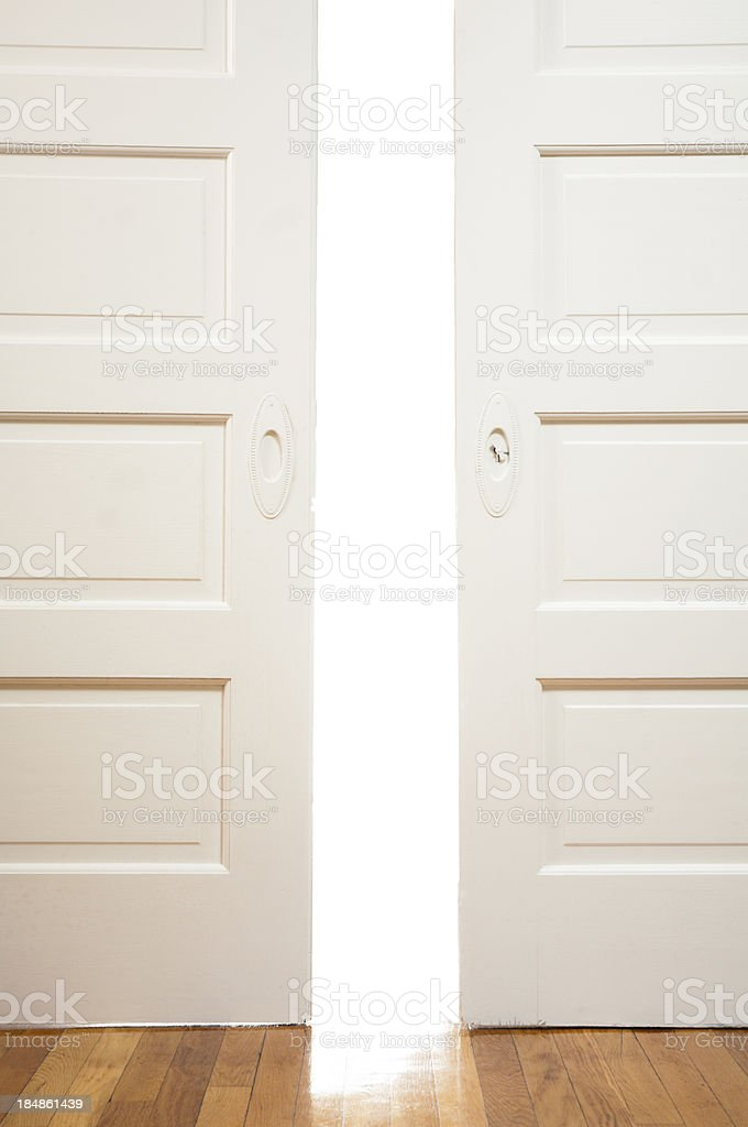 Antique sliding pocket doors ajar stock photo