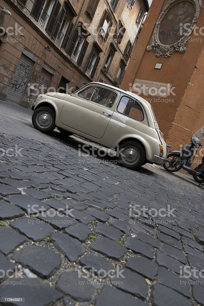 Antique Small Car Cobblestone Street royalty-free stock photo