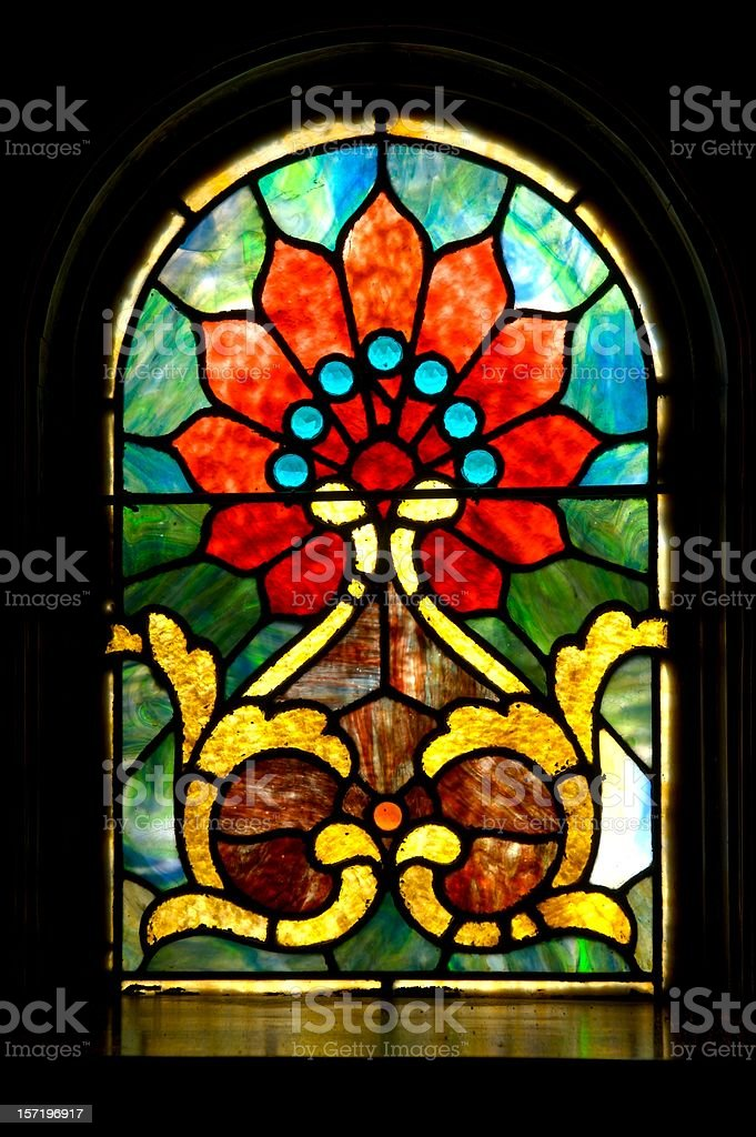 Antique Stained Glass in Sanctuary stock photo