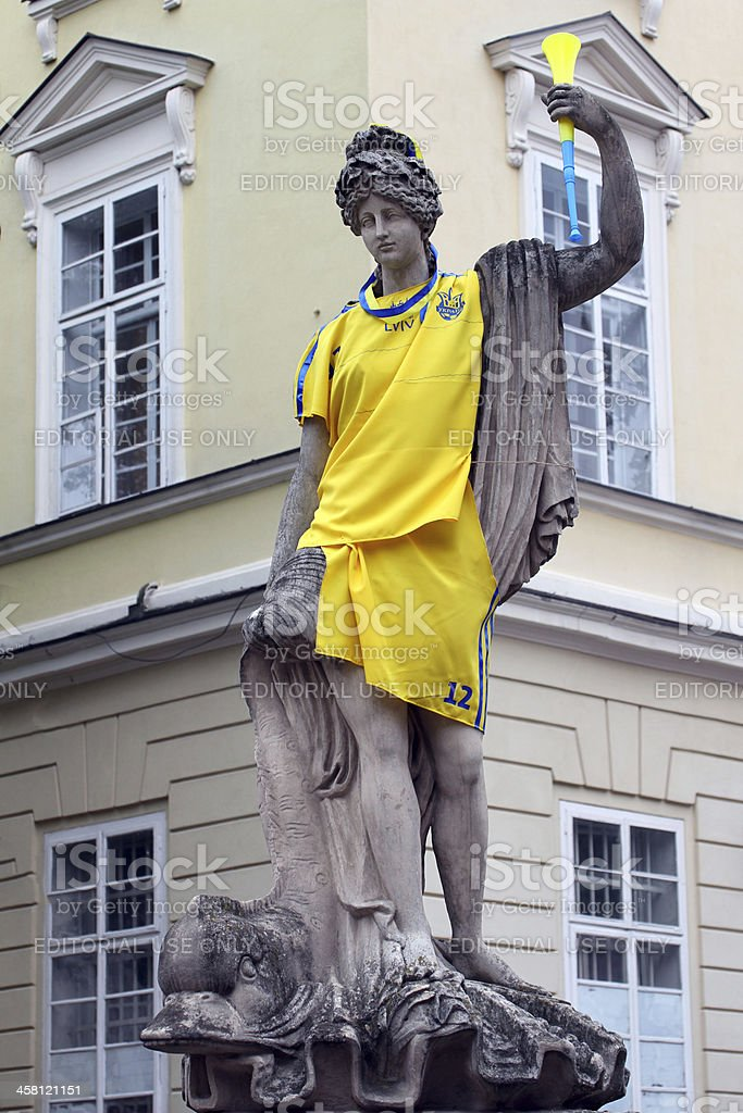 Antique statue dressed in soccer uniform royalty-free stock photo
