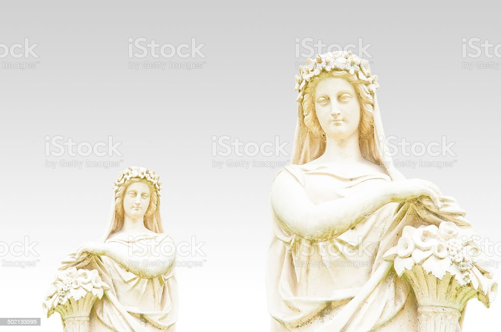 Antique statue of young woman stock photo