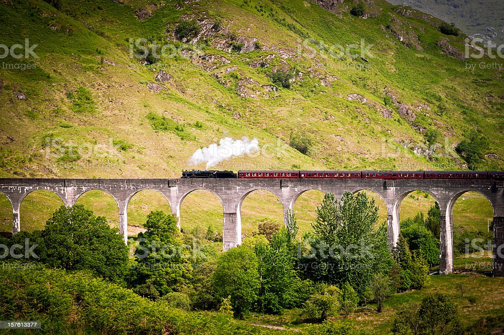 Antique Steam Train running on a Viaduct stock photo