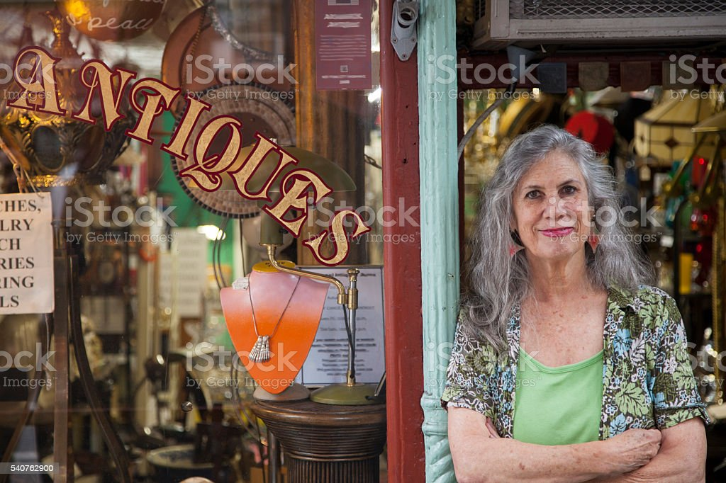 Antique store owner stock photo