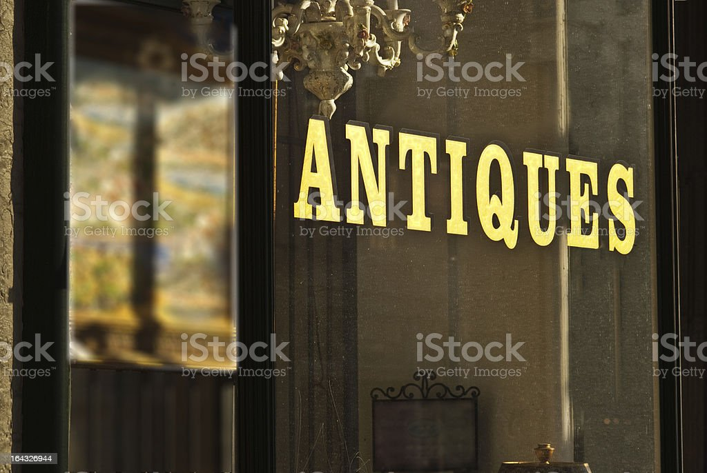 Antique store window sign wilth gold letters stock photo