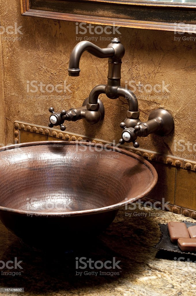 Antique style bathroom sink with bars of soap on plate stock photo