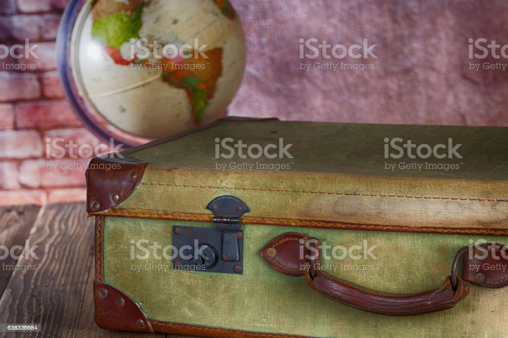 Antique Suitcase with World Ball stock photo