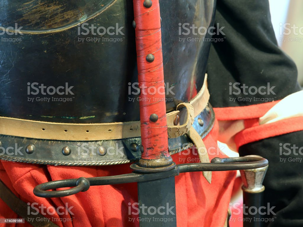antique sword hilt of the King in a medieval castle stock photo