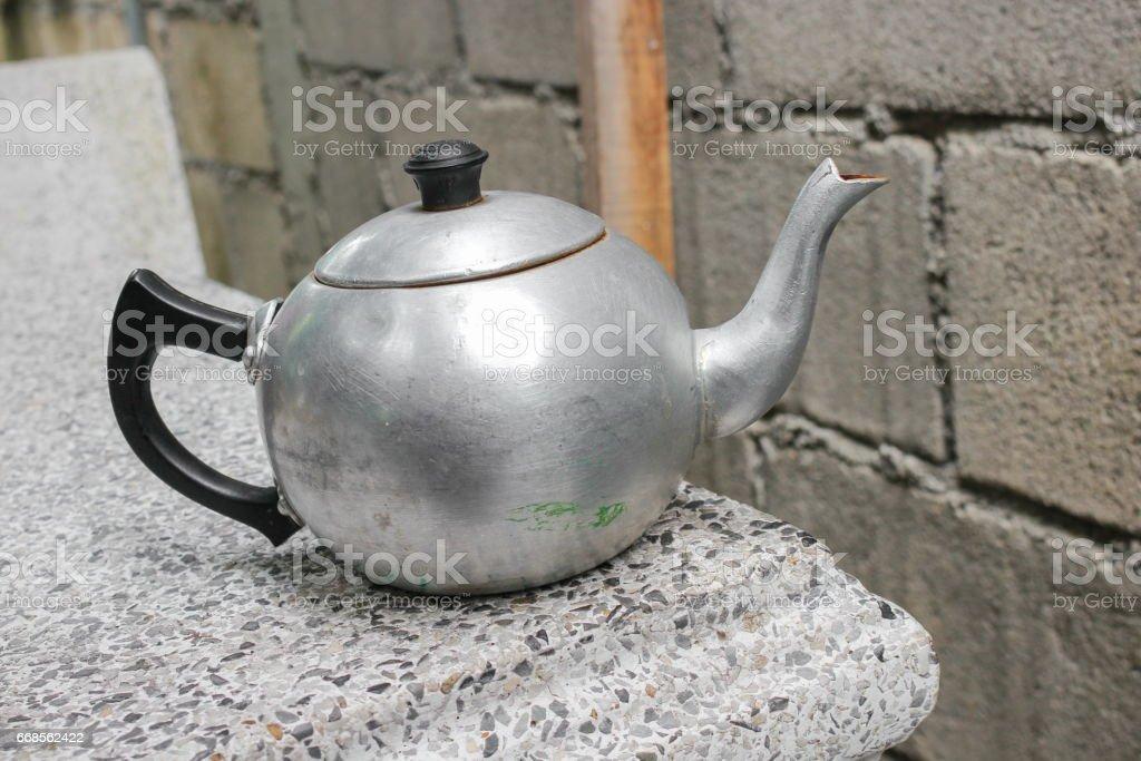Antique teapot Thailand on table terrazzo background stock photo