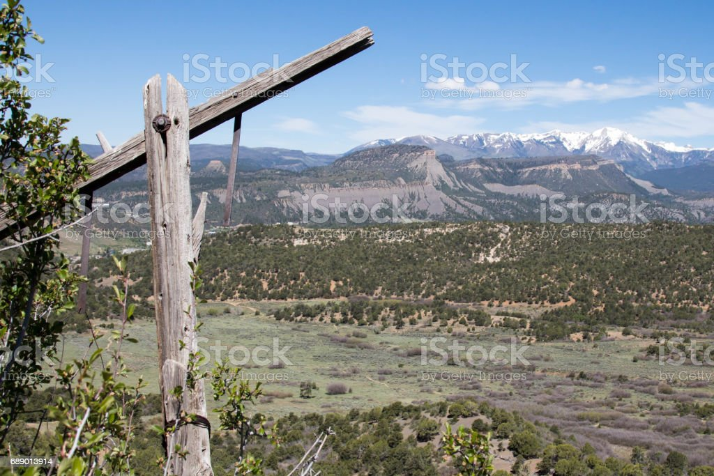 Antique telegraph pole with the San Juan mountains behind stock photo