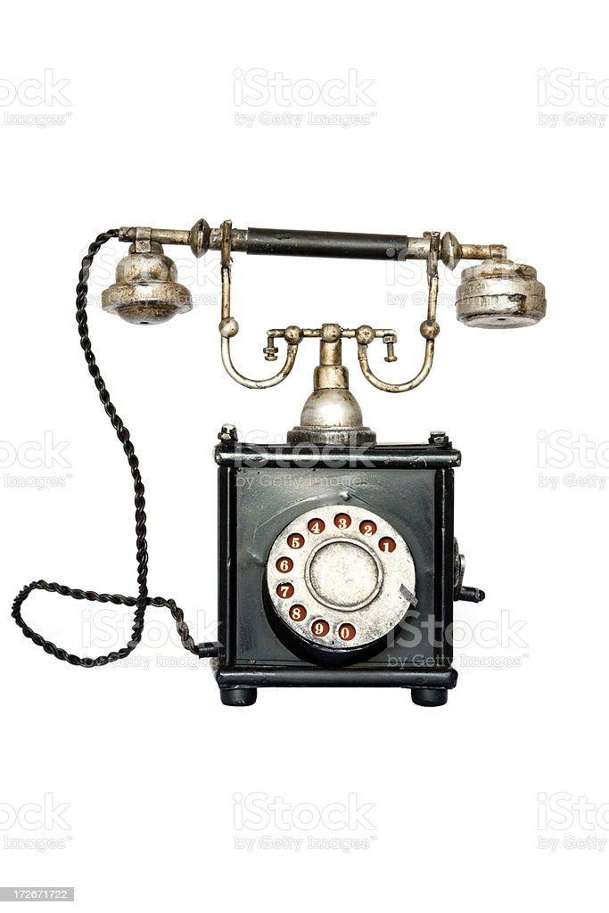 antique telephone rusted and isolated royalty-free stock photo