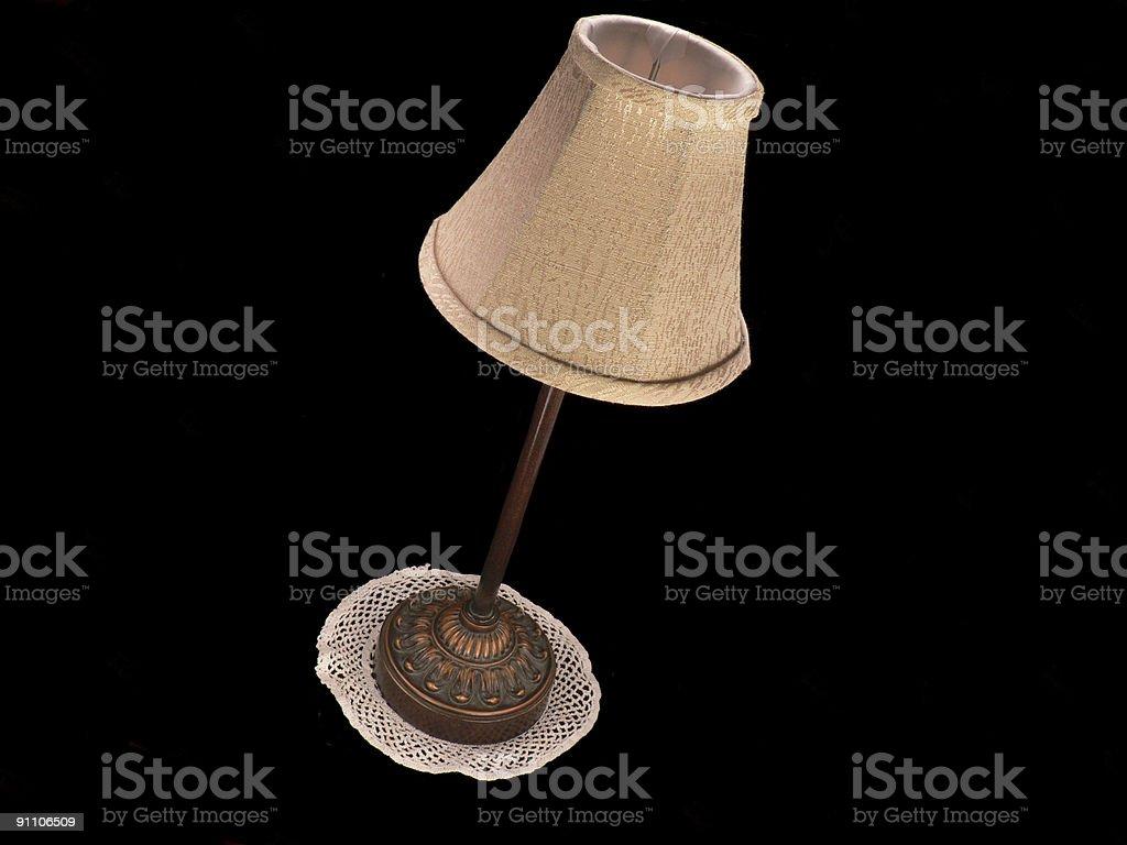 Antigo inclinada luminária de mesa com Pequeno Guardanapo foto royalty-free
